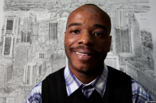 Stephen Wiltshire in front of one of his cityscapes