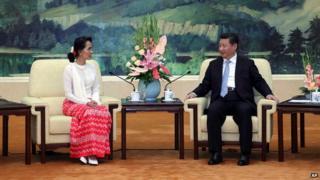 Aung San Suu Kyi and Xi Jinping in Beijing on 11 June 2015