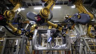 Robotic arms on factory line in Ford truck plant