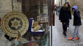 People standing near a gift shop in the old Jewish Quarter of Toledo in Spain