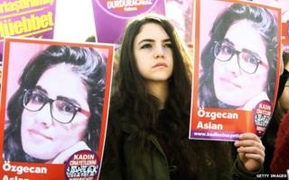 A young Turkish women holds a poster of Ozgecan Aslan during a protest against her killing in Ankara, in February 2015