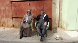 Two men relaxing in Baghdad