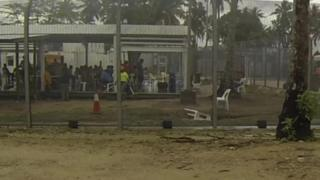 View through fence to an area where detainees are, on Manus Island