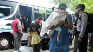 Migrants from Bangladesh, Myanmar and Sri Lanka arriving in Kupang, East Nusa Tenggara province, after they were intercepted en route to New Zealand by the Australian navy