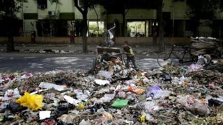 A young boy amid mountains of garbage in New Delhi