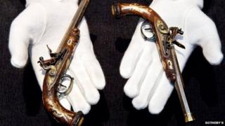 A pair of gold-encrusted pistols belonging to the son of Napoleon Bonaparte