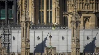Workman on roof of Parliament