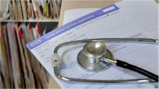 A stethoscope on a GP registration form