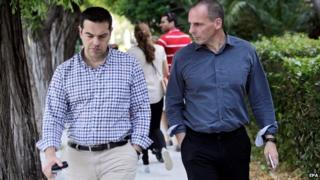 Greek Premier Alexis Tsipras (L) and Greek Finance Minister Yanis Varoufakis (R)