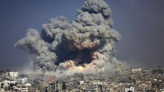 File photo: Smoke and fire from an Israeli strike rise over Gaza City, 29 July 2014