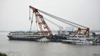The Eastern Star cruise ship is seen being towed to a safer area, after it capsized in the Jianli section of the Yangtze River, in Huarong county, Hunan province, China, June 10, 2015.