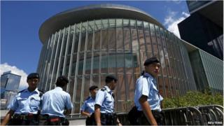 Policemen patrol outside the Legislative Council building in Hong Kong