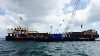 Barge carrying out installation work on one of the new outfall pipes at Belle Greve