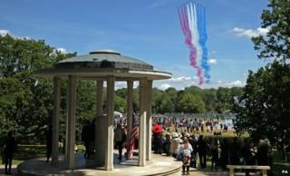 The Red Arrows fly over the Magna Carta memorial at Runnymede, near Egham, Surrey, during the 800th anniversary