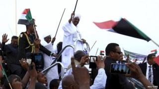 Omar al-Bashir is welcomed by supporters at Khartoum airport
