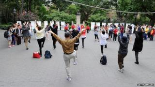 Volunteers participate in a demonstration during the 5th International Heath Qigong Forum at Washington Square Park on 18 August 2013 in New York Cit