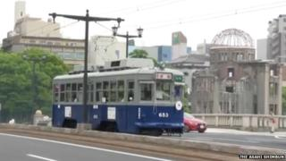The tram passing in front of the Hiroshima Peace Memorial