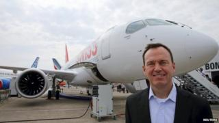 Bombardier Commercial President Fred Cromer poses in front of Bombardier CS100 plane