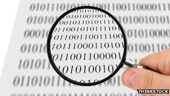 Magnifying glass over data