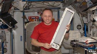 Michael Fincke holds a a general luminaire assembly unit