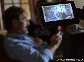 McAfee being filmed