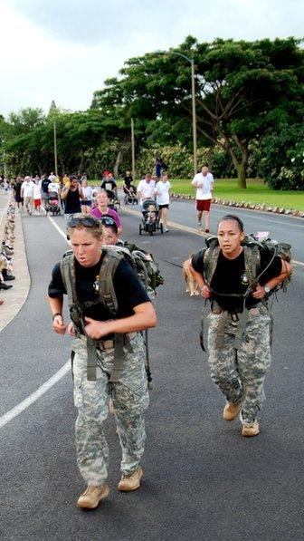 Women soldiers run in combat uniform