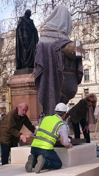 Gandhi statue being put in place
