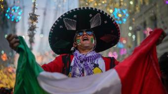 A Mexican football fan enjoys the World Cup party atmosphere on Nikolskaya Street, near Red Square in Moscow, Russia.