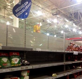 """Supermarket shelves and sign reading """"Made in socialism"""""""