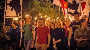 Sellner on a torch-lit march near Vienna in September 2017