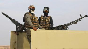 File photo showing Iraqi paramilitary fighters standing guard near the Iraq-Syria border on 11 November 2018