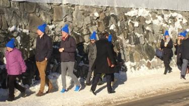 People wearing Zurich Insurance hats