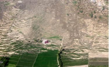 Aerial view of a collapsed hillside in Palu