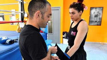 Iranian boxer Sadaf Khadem (R) with her trainer, Mahyar Monshipour (L)