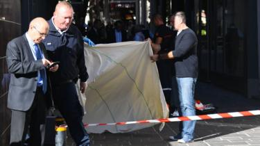 Forensics work on the site where Pascal Filoe, head of the municipal police, was stabbed to death in Rodez, southern France