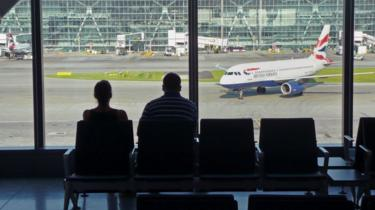 Airline passengers at Heathrow Airport terminal Five
