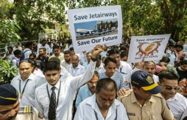 "Indian Jet Airways employees hold placards and shout slogans against their company""s management as they march towards the Jet Airways head office from the Chhatrapati Shivaji Maharaj International Airport"