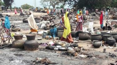 omen sift through the remains of a market blown up during an attack on September 20, 2018, in Amarwa, some 20 kilometres (12 miles) from Borno state capital Maiduguri.