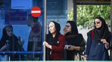 Iranian women wait in a bus station on the eve of first anniversary of US withdrawal from nuclear deal, in a street of Tehran, Iran, 7 May 2019.