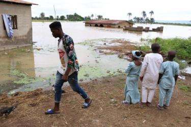 Residents look at the damage following heavy rain in the Nigerian town of Lokoja, in Kogi State, on September 14, 2018.