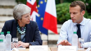 Theresa May meeting Emmanuel Macron in southern France in August 2018
