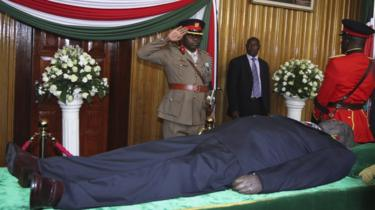 A military officer salutes in front of the body of late Daniel arap Moi, Kenya