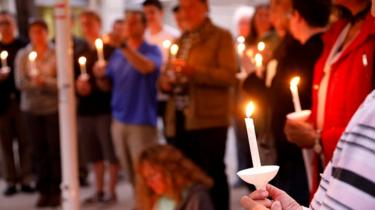 A candlelight vigil is held at Rancho Bernardo Community Presbyterian Church for victims of a shooting in Poway, north of San Diego, California, April 27, 2019