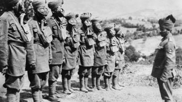 A group of Indian soldiers doing gas mask training