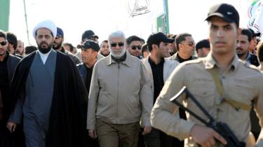Image shows Abu Mahdi al-Muhandis (centre)
