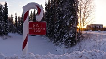 A Candy Cane sign saying Santa Claus Lane
