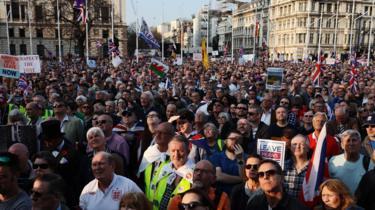Pro Brexit demonstrators gather for a speech by Nigel Farage in central London