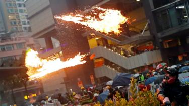 An anti-extradition bill protester throws a Molotov cocktail