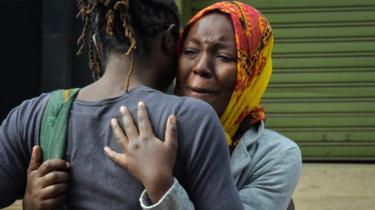 People grieving in Nairobi, Kenya in the aftermath of the terror attack on the Dusit compound