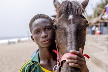 Man and horse looking at camera